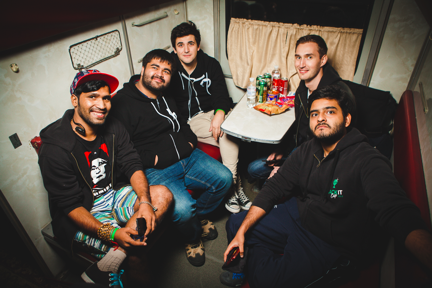 Sandeep Singh, Parth Malhotra, Patrik Fehrenbach, Julian Keller and Shahmeer Amir inside a compartment of the iconic Soviet 'platskarta' economy class railway car, temporary turned into a party train from Kharkiv to Kyiv