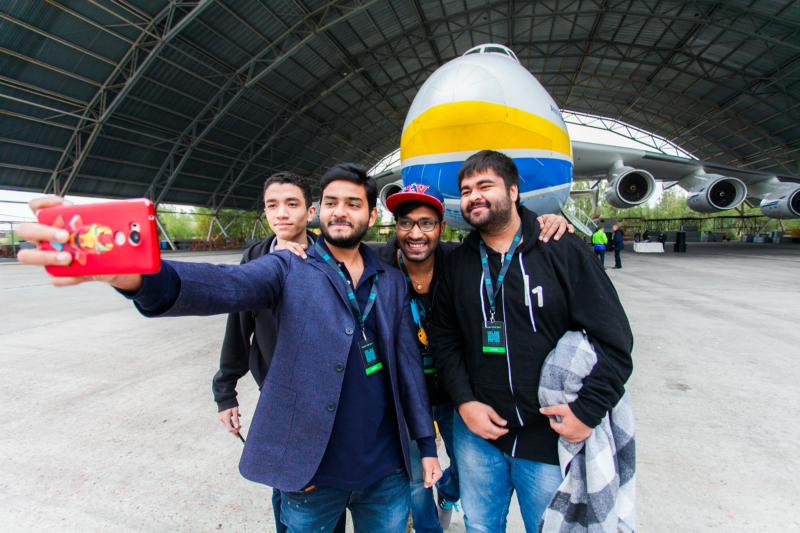 Mazen Gamal from Egypt, Shahmeer Amir from Pakistan, Sandeep 'Geekboy' Singh and Parth Malhotra from India taking a selfie in front of Antonov 225 'Mriya'